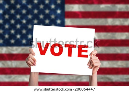 Vote card with USA flag background - stock photo