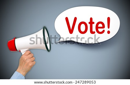Vote ! - Female hand with megaphone and speech bubble - stock photo