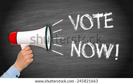 Vote Now ! - Female hand with megaphone and text - stock photo