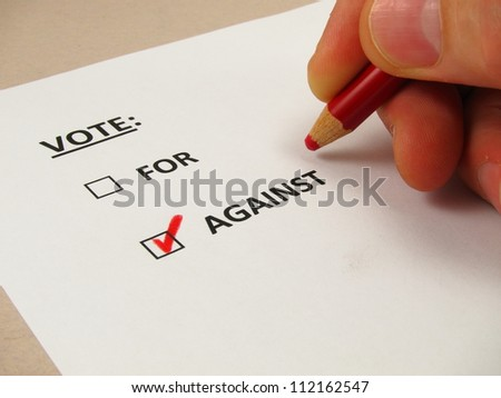 Voting ballot with 'against' box checked - stock photo