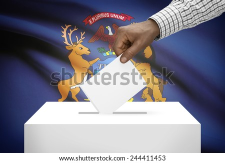Voting concept - Ballot box with US state flag on background - Michigan - stock photo