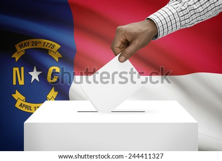 Voting concept - Ballot box with US state flag on background - North Carolina - stock photo