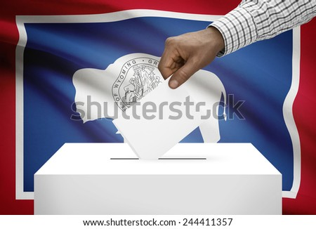 Voting concept - Ballot box with US state flag on background - Wyoming - stock photo