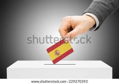 Voting concept - Male inserting flag into ballot box - Spain - stock photo