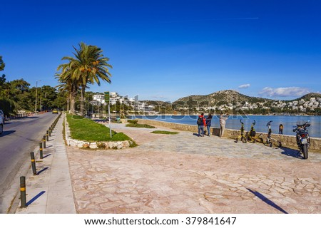 VOULIAGMENI, GREECE - FEBRUARY 21 2016: The beautyful beach of Vouliagmeni near the Astir Resort Complex. It is located about 20km south of Athens and belongs to the elite area of the Athenian Riviera - stock photo