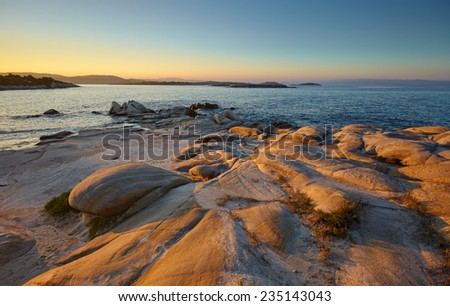 Vourvourou - Karidi beach, Northern Greece at sunset - stock photo