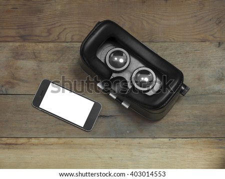VR Glasses and smartphone with clipping path for screen on wooden floor. - stock photo