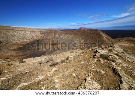 vulcanic timanfaya  rock stone sky  hill and summer in los volcanes lanzarote spain - stock photo