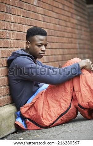 Vulnerable Teenage Boy Sleeping On The Street - stock photo