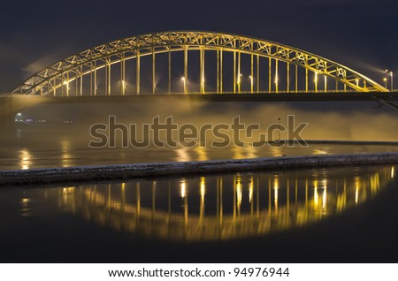 Waal bridge Nijmegen, the Netherlands, reflection and fog - stock photo