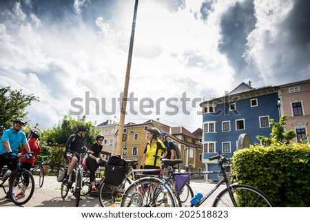 WACHAU VALLEY,AUSTRIA-MAY 9,2014:group of cyclists is resting at cycle path near danube river in Austria during a cloudy day - stock photo