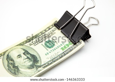 wad of dollar bills with a clamp - stock photo