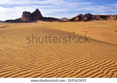 Wadi Rum desert landscape at sunset time, Jordan - stock photo