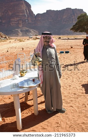 Wadi Rum, Jordan: Jan. 7, 2009:  A Bedouin man stands ready to serve tea to passing visitors at Wadi Rum, a favorite tourist destination also known as The Valley of the Moon.  - stock photo