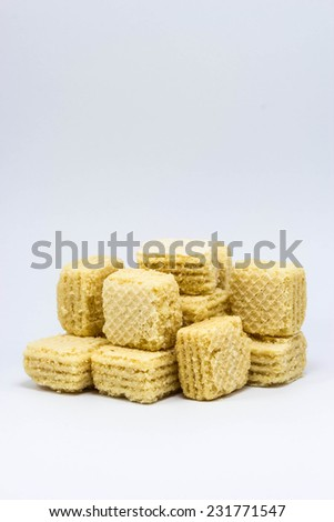 Wafers with chocolate and milk on a white background - stock photo