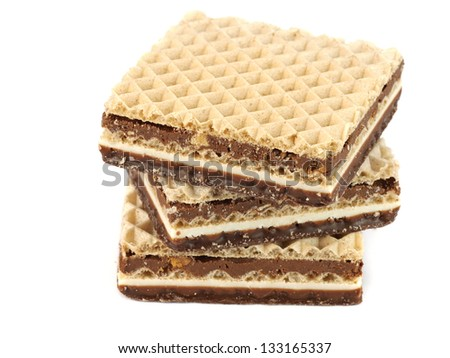Wafers with chocolate on a white background - stock photo