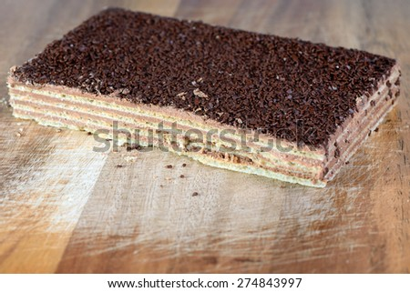 Waffle cake covered with truffle crumbs - stock photo