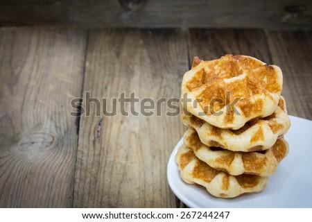 waffle on wooden background - stock photo