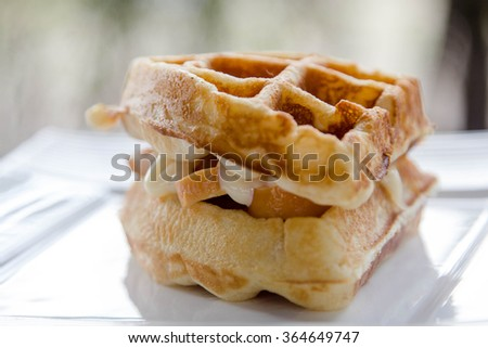Waffle sandwiches with sausage and mayonnaise - stock photo