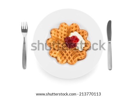 Waffle with jam and whipped cream. - stock photo