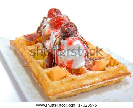 Waffle with vanilla ice cream coating strawberry and cocollate - stock photo
