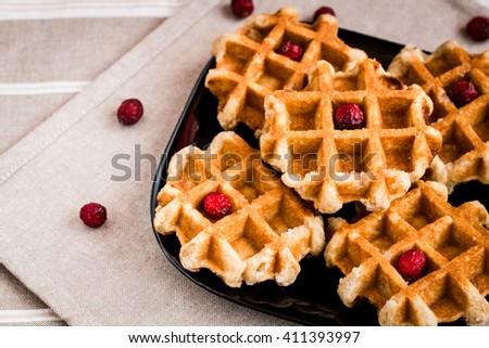 waffles, sugar waffles, Belgian waffles, waffles with berries, waffles close-up - stock photo
