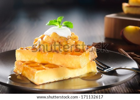 waffles with diced apple cooked, cinnamon, caramel syrup and yogurt topping - stock photo
