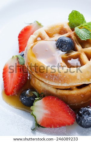 waffles with strawberry and blueberry and caramel sauce - stock photo