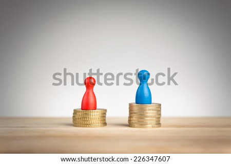 Wage gap concept with blue figure symbolizing men and red pawn women - stock photo