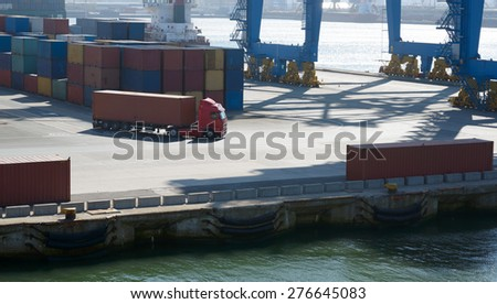 wagon carries a large container in the port terminal  - stock photo