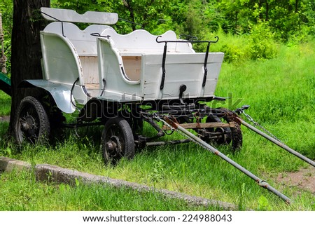 Wagon in the yard of the rural house in Ukraine  - stock photo