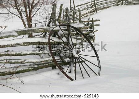 Wagon Wheel in Snow I - stock photo