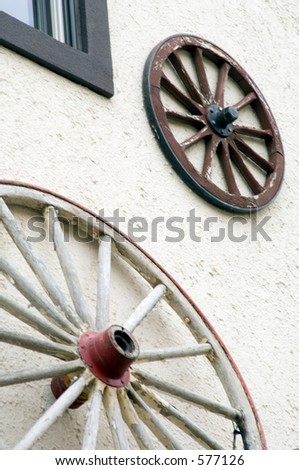 Wagon wheels above entrance to store - stock photo