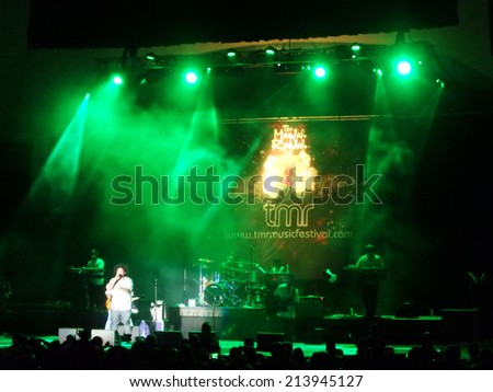WAIKIKI, OAHU - JULY 25:  J Boog sings on stage with green lighting at MayJah RayJah Concert at the Waikiki Shell taken July 25, 2014 Waikiki, Hawaii. - stock photo