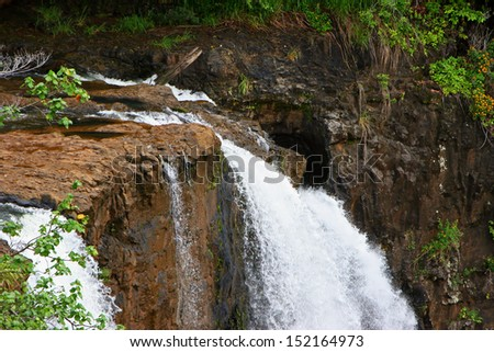 Wailua Falls Tiered Waterfall Kauai Hawaii Island - stock photo