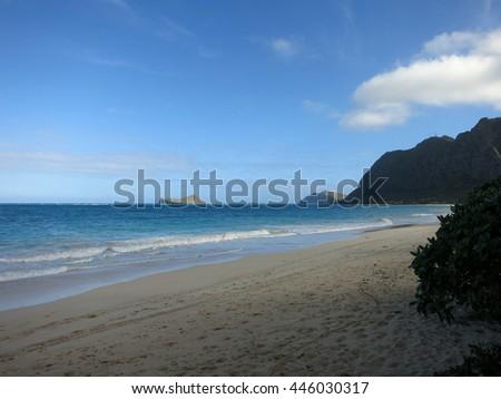 Waimanalo Beach during the day looking towards Rabbit, Rock islands and Makapuu point on Oahu, Hawaii. - stock photo