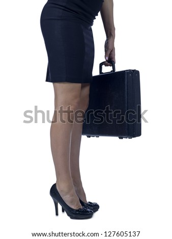 Waist-down shot of a standing businesswoman holding a black briefcase - stock photo