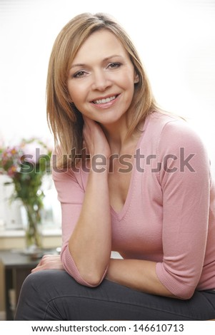 waist up portrait of mature caucasian woman in her 40's - stock photo