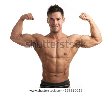 Waist-up portrait of muscular man flexing his biceps against white background - stock photo