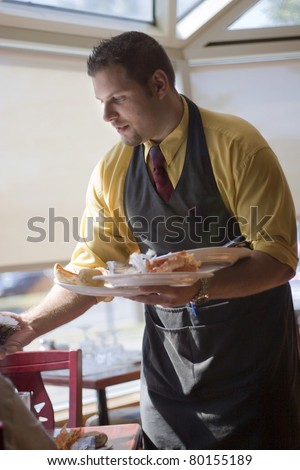 Waiter cleaning table - stock photo