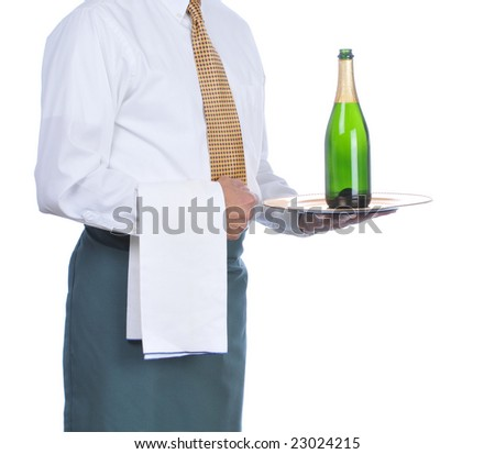 Waiter holding a bottle of champagne on a tray isolated over white - torso only - stock photo