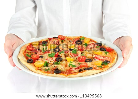 Waiter holding a dish with baked pizza on white background close-up - stock photo