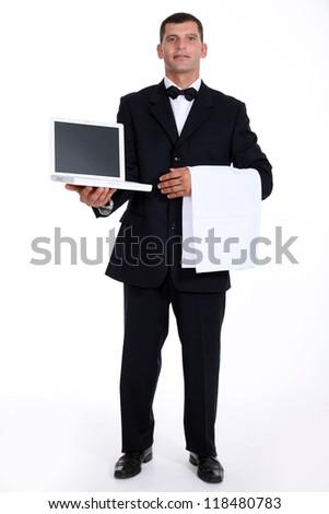 waiter holding a laptop - stock photo