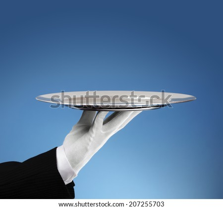 Waiter holding an empty silver platter ready for product placement - stock photo