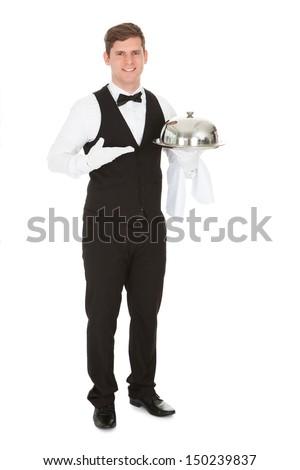 Waiter Holding Empty Silver Tray Over White Background - stock photo