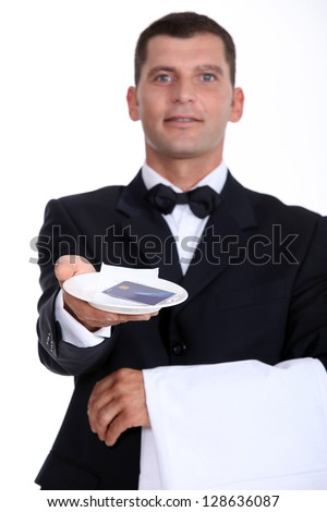 Waiter holding tray with credit card - stock photo