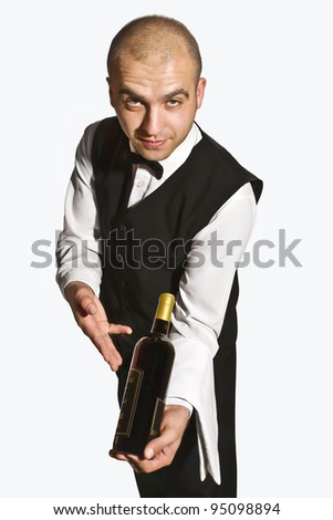 Waiter offers red wine - stock photo