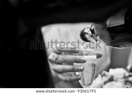 Waiter Pouring Champagne - stock photo