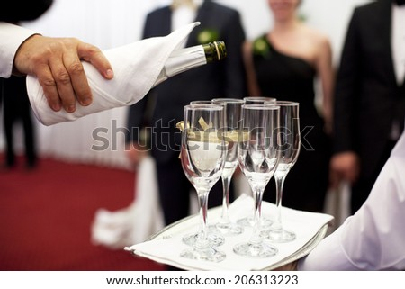 Waiter serving champagne - stock photo