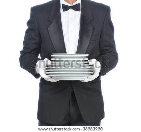 Waiter Wearing a Tuxedo carrying a Stack of plates, isolated on white - stock photo